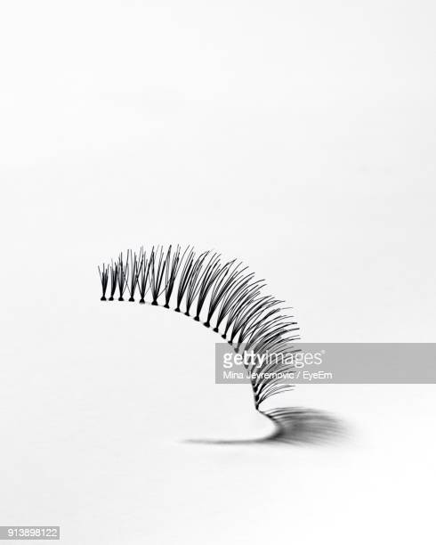 close-up of false eyelash against white background - false eyelash stock pictures, royalty-free photos & images