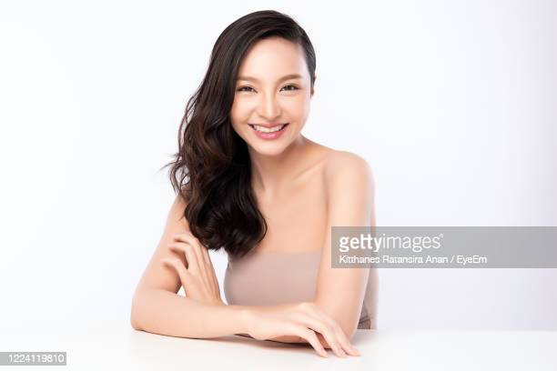 close-up of fashion model against white background - one young woman only stock pictures, royalty-free photos & images