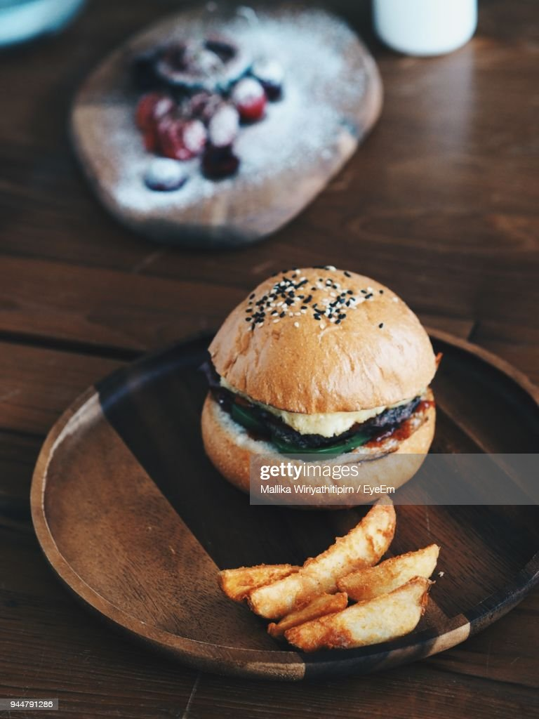 Close-Up Of Fast Food In Wooden Plate : Stock Photo