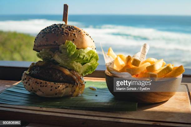 Close-Up Of Fast Food Served On Cutting Board