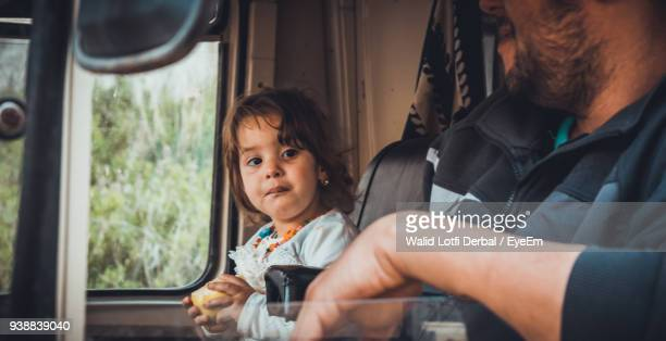 close-up of father and daughter sitting in land vehicle - algeria stock pictures, royalty-free photos & images