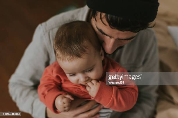 close-up of father with baby - beschützer stock-fotos und bilder