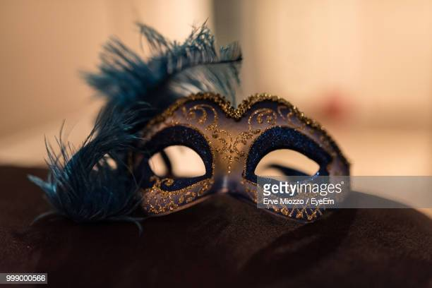 Close-Up Of Feather Mask On Table