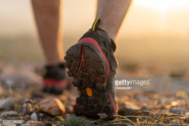 close-up of feet of a hiker - hiking boot stock pictures, royalty-free photos & images