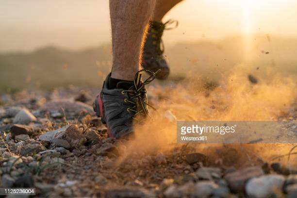 close-up of feet of a trail runner - cross country running stock pictures, royalty-free photos & images