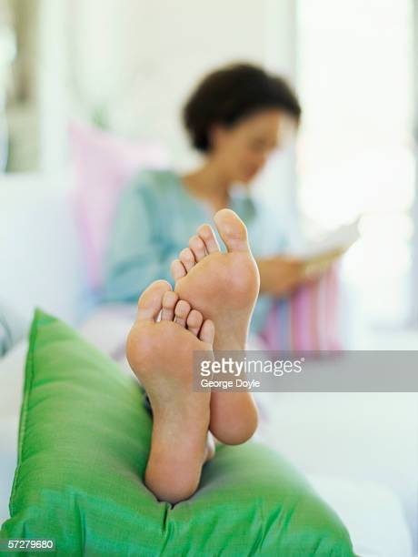 Close-up of feet of a young woman reclining