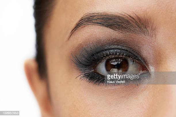 close-up of female eye with make-up - smokey eyeshadow stock pictures, royalty-free photos & images