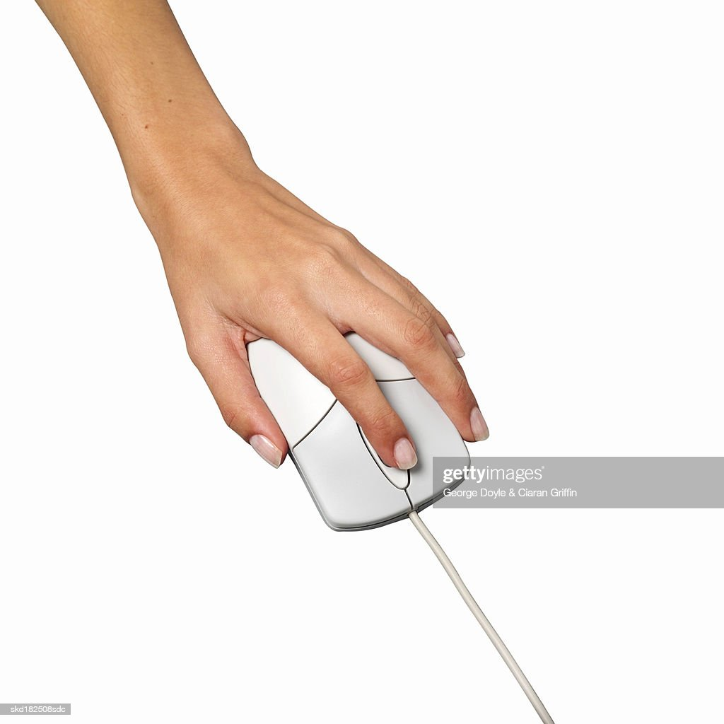 Closeup Of Female Hand Clicking On Computer Mouse Stock