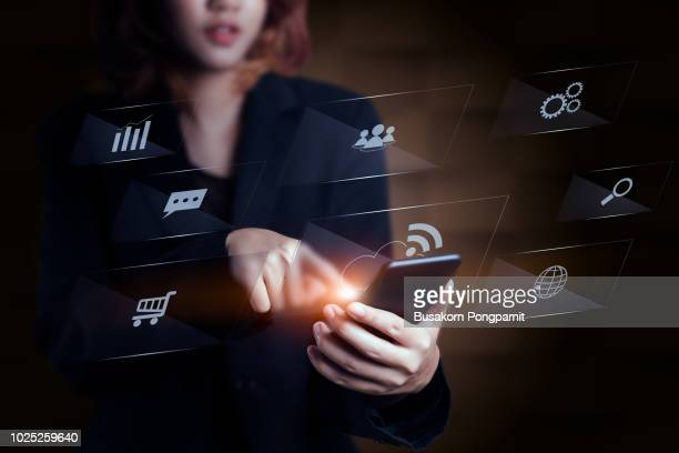 Close-up of female hands touching digital smartphone with business diagram technology