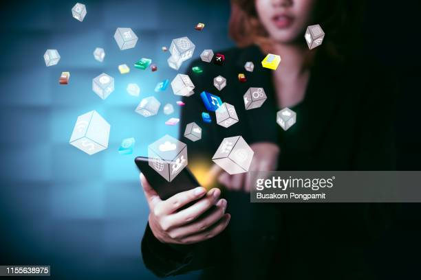 close-up of female hands touching digital smartphone with business diagram technology - community icon stock pictures, royalty-free photos & images