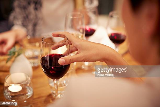 close-up of female holding glass with redwine - drink stock pictures, royalty-free photos & images
