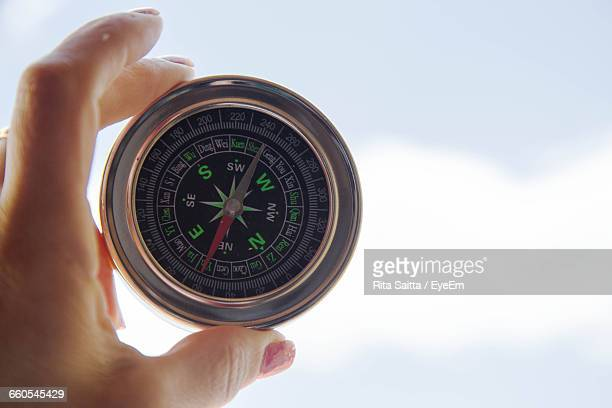 Close-Up Of Female Holding Navigational Compass