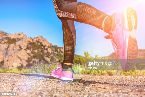 close-up of female legs hiking /running - pink shoe stock pictures, royalty-free photos & images