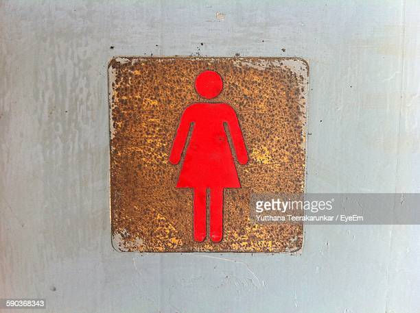Close-Up Of Female Sign On Toilet Door