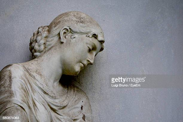 close-up of female statue against wall - female likeness stock pictures, royalty-free photos & images