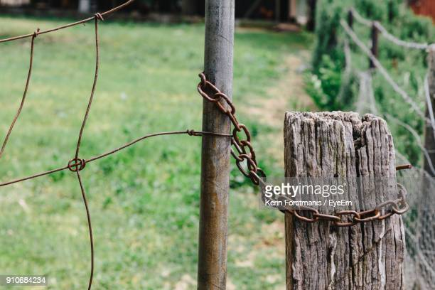 Close-Up Of Fence By Wooden Post