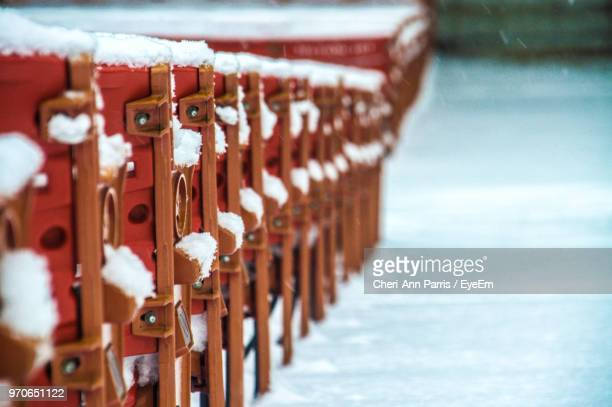 Close-Up Of Fence Covered With Snow