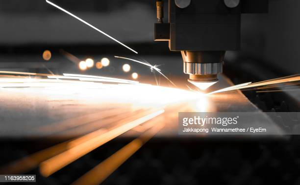 close-up of fiber laser cutting metal - image focus technique stock pictures, royalty-free photos & images