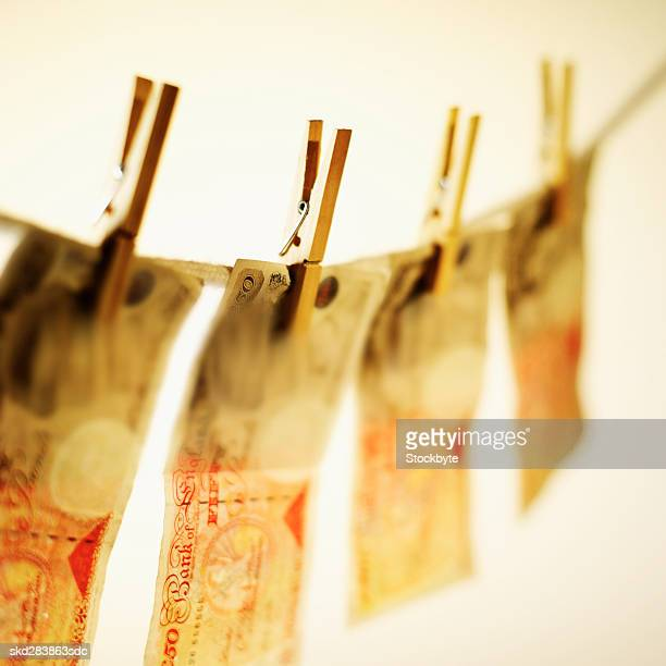 close-up of fifty pound notes hanging on clothesline - fifty pound note stock photos and pictures