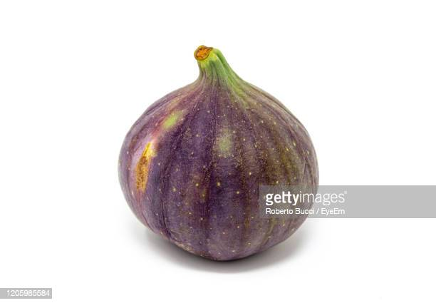 close-up of fig against white background - fig stock pictures, royalty-free photos & images