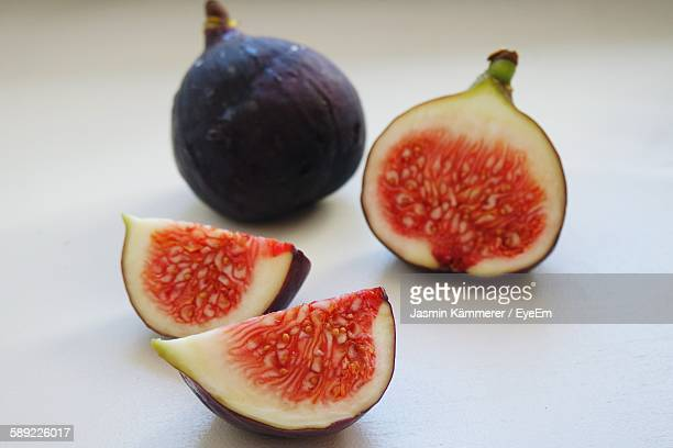 Close-Up Of Figs Against White Background