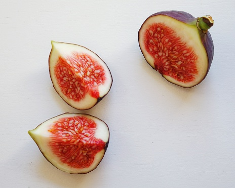 Close-Up Of Figs Against White Background - gettyimageskorea