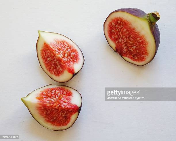 close-up of figs against white background - fig stock pictures, royalty-free photos & images