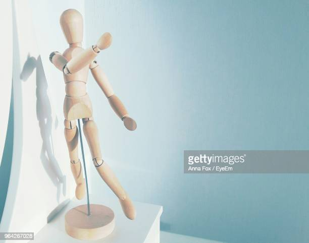 close-up of figurine against wall - dolly fox stock pictures, royalty-free photos & images