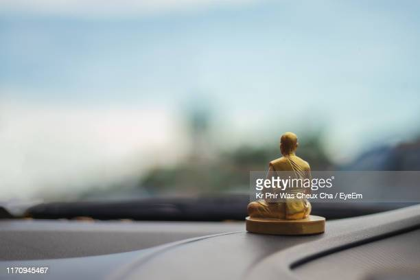 close-up of figurine on dashboard of car - dashboard stock pictures, royalty-free photos & images