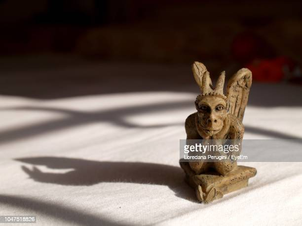 close-up of figurine on table - loredana perugini stock pictures, royalty-free photos & images