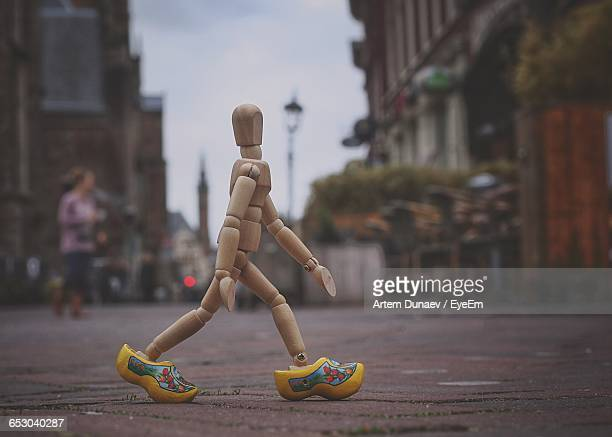 close-up of figurine walking on footpath - puppet stock pictures, royalty-free photos & images
