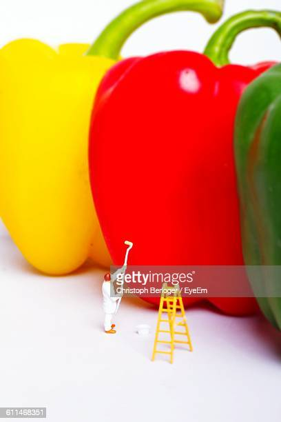 close-up of figurine with multi colored bell peppers - human representation stock pictures, royalty-free photos & images