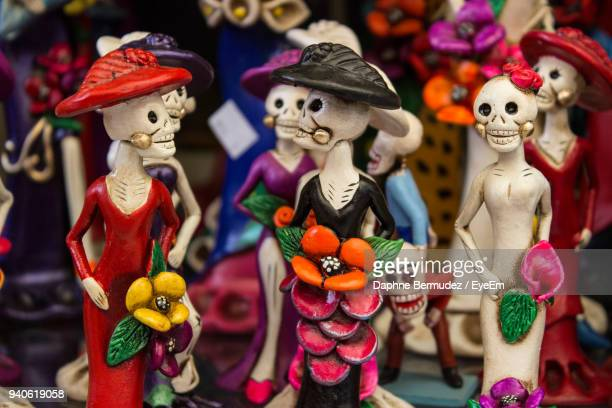 close-up of figurines for sale during halloween - human skull stock pictures, royalty-free photos & images