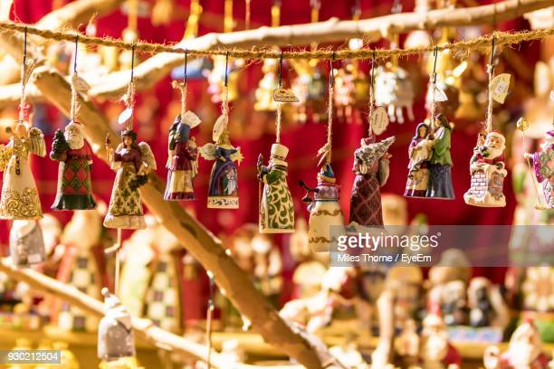 close-up of figurines hanging for sale - christmas market stock pictures, royalty-free photos & images