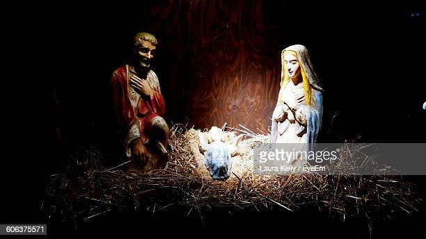 close-up of figurines in crib during christmas - jesus birth stock pictures, royalty-free photos & images