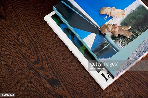 close-up of figurines on magazines on a table - small group of objects stock pictures, royalty-free photos & images