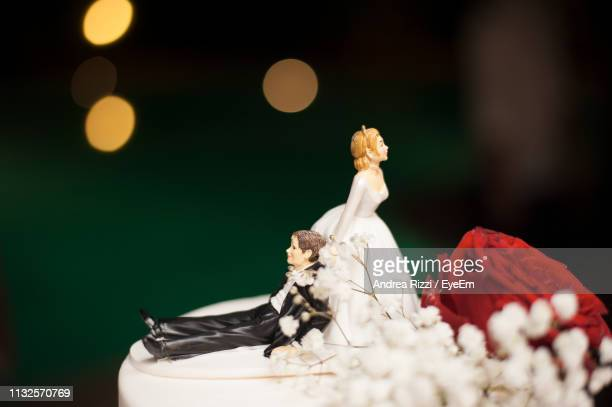 close-up of figurines on wedding cake - andrea rizzi stock pictures, royalty-free photos & images