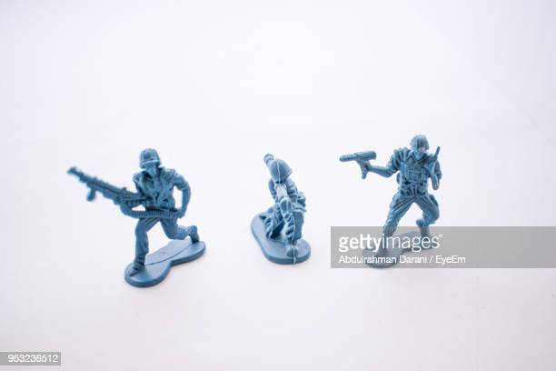 close-up of figurines over white background - army soldier toy stock pictures, royalty-free photos & images