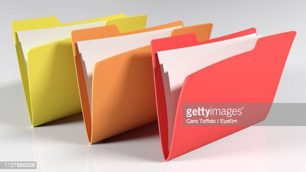 close-up of file folders against gray background - ファイル ストックフォトと画像