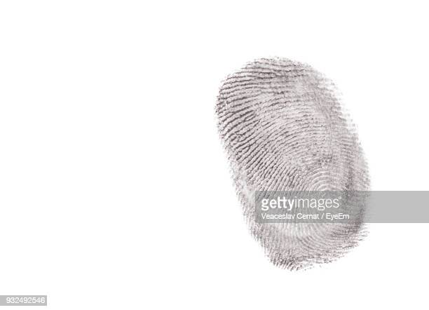 Close-Up Of Finger Print Against White Background