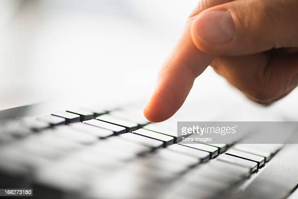 close-up of finger typing on keyboard - datortangent bildbanksfoton och bilder