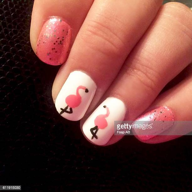 Close-up of fingernail showing Flamingo Nail Art