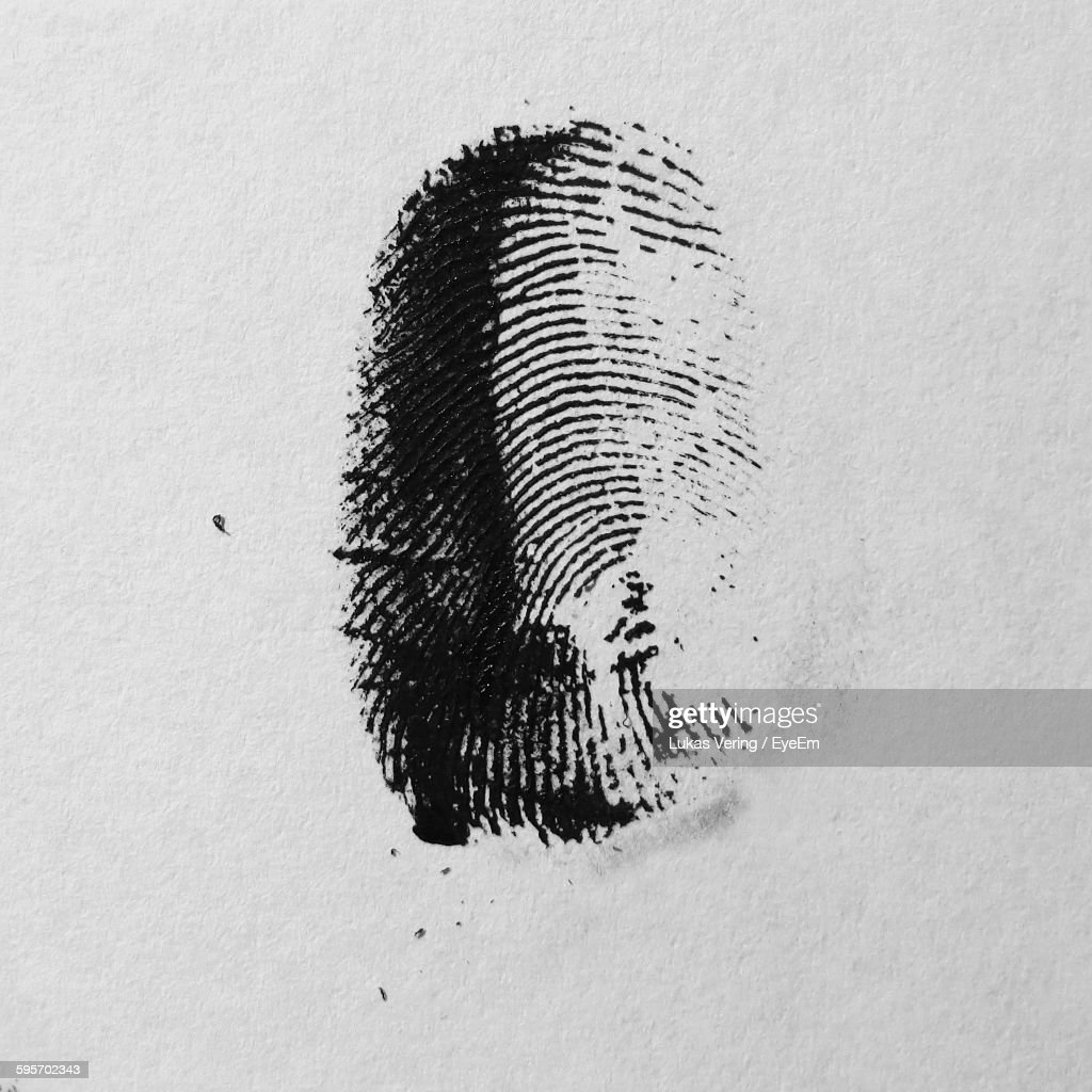 Close-Up Of Fingerprint On Paper : Stock Photo