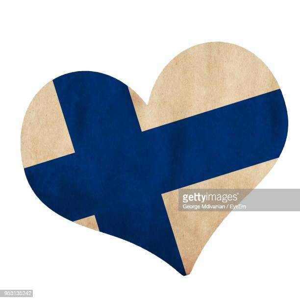 close-up of finnish flag in heart shape over white background - finnish flag stock photos and pictures