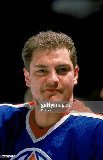 Closeup of Finnish ice hockey player Esa Tikkanen of the Edmonton Oilers on the ice late 1980s He sports a slightly bloodied lip