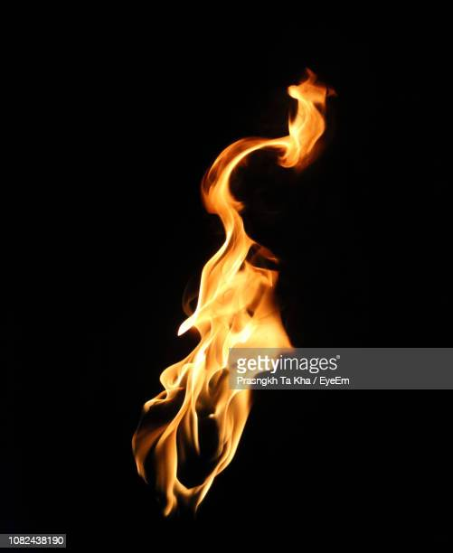 close-up of fire against black background - flame stock pictures, royalty-free photos & images