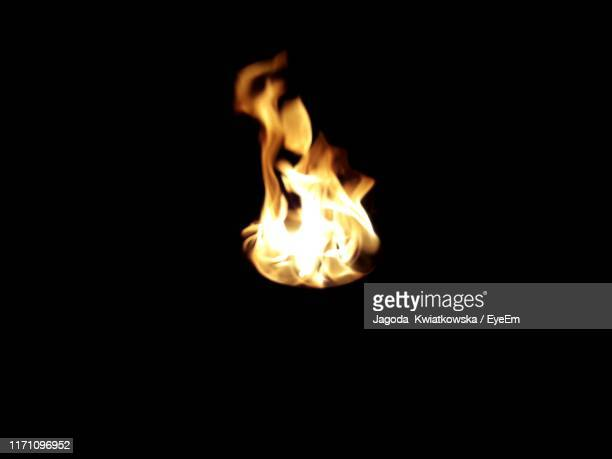 close-up of fire against black background - 炎 ストックフォトと画像
