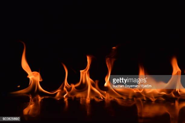close-up of fire against black background - fire natural phenomenon stock pictures, royalty-free photos & images