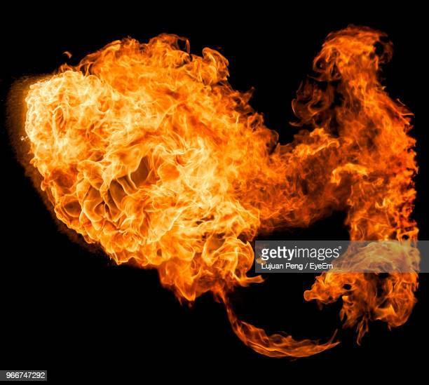 close-up of fire against black background - detonate stock photos and pictures