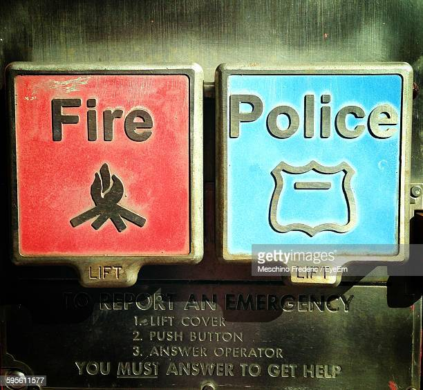 Close-Up Of Fire And Police Alarm Boxes